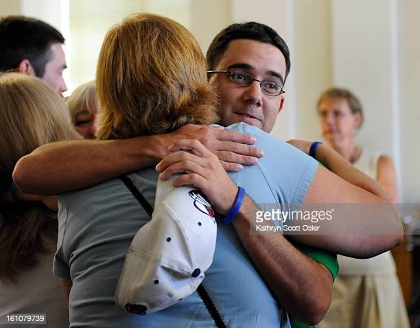 GRAFNER_KSO_8_12_08194 Josh Norris Chandler Grafner's biological father hugs other family members after Phillips is found guilty of Grafner's murder...