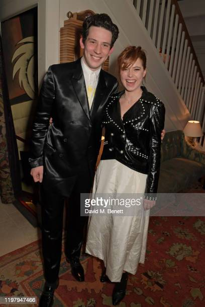Josh O'Connor and Jessie Buckley attend the Charles Finch CHANEL PreBAFTA Party at 5 Hertford Street on February 1 2020 in London England