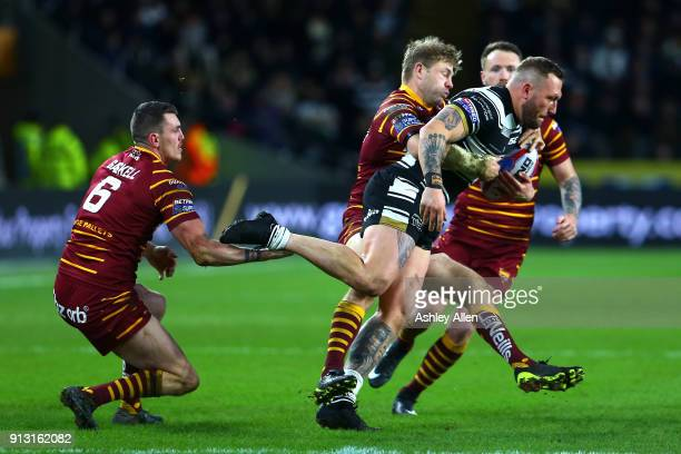 Josh of Hull FC attempts to get away from Lee Gaskell and Jordan Rankin of Huddersfield Giants during the BetFred Super League match between Hull FC...