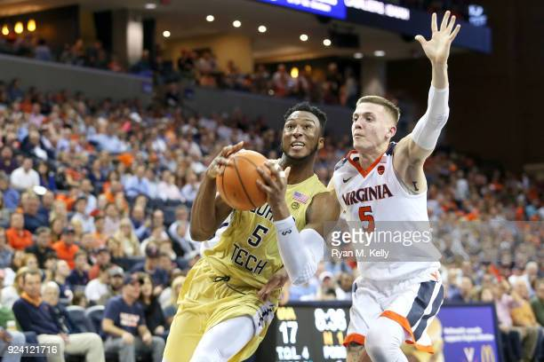 Josh Okogie of the Georgia Tech Yellow Jackets drives past Kyle Guy of the Virginia Cavaliers in the first half during a game at John Paul Jones...