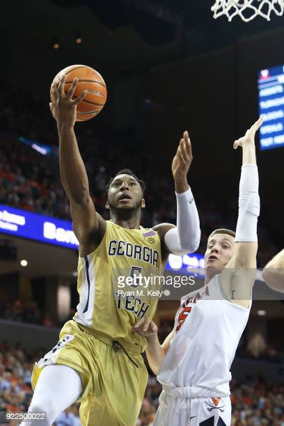 Josh Okogie of the Georgia Tech Yellow Jackets goes up for a shot over Kyle Guy of the Virginia Cavaliers in the first half during a game at John...