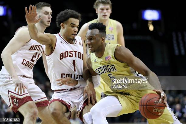 Josh Okogie of the Georgia Tech Yellow Jackets works against Jerome Robinson of the Boston College Eagles in the first half during the first round of...