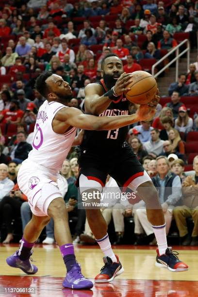 Josh Okogie of the Minnesota Timberwolves defends James Harden of the Houston Rockets in the first half at Toyota Center on March 17 2019 in Houston...