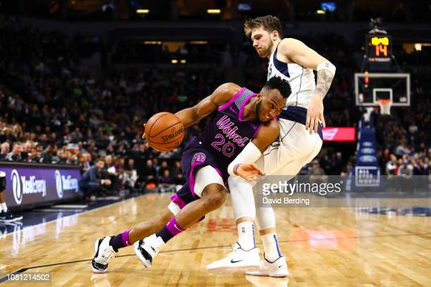 Josh Okogie of the Minnesota Timberwolves dribbles the ball while Luka Doncic of the Dallas Mavericks defends in the fourth quarter at Target Center...