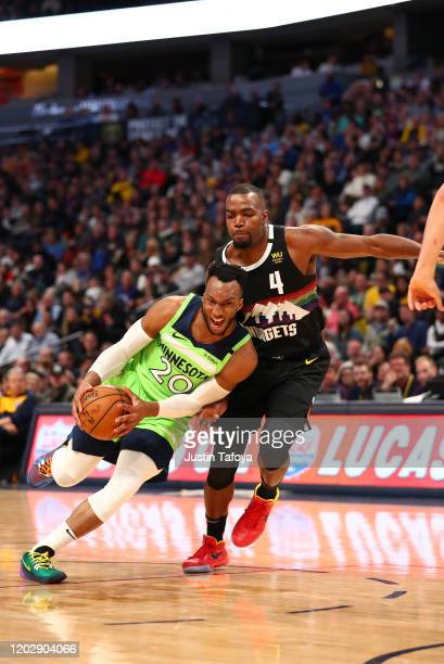 Josh Okogie of the Minnesota Timberwolves drives to the basket against Paul Millsap of the Denver Nuggets at Pepsi Center on February 23 2020 in...