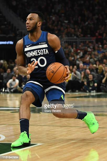 Josh Okogie of the Minnesota Timberwolves handles the ball during a game against the Milwaukee Bucks at Fiserv Forum on February 23 2019 in Milwaukee...