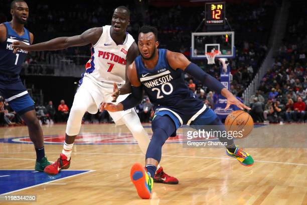Josh Okogie of the Minnesota Timberwolves tries to get around the defense of Thon Maker of the Detroit Pistons during the first half at Little...