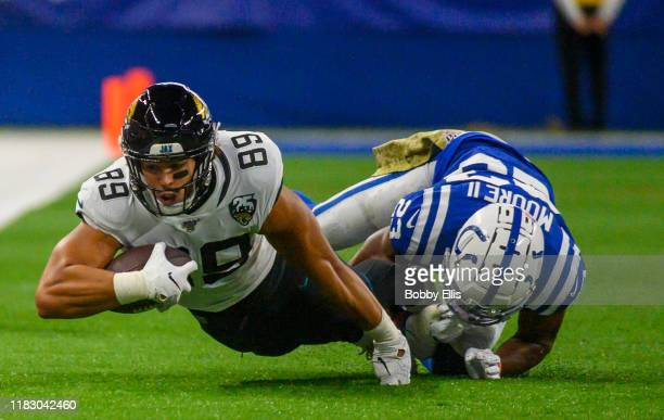 Josh Oliver of the Jacksonville Jaguars makes a first down catch during the first quarter of the game against the Indianapolis Colts at Lucas Oil...