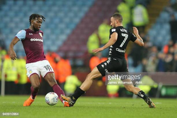 Josh Onomah of Aston Villa and Kemar Roofe of Leeds United during the Sky Bet Championship match between Aston Villa and Leeds United at Villa Park...