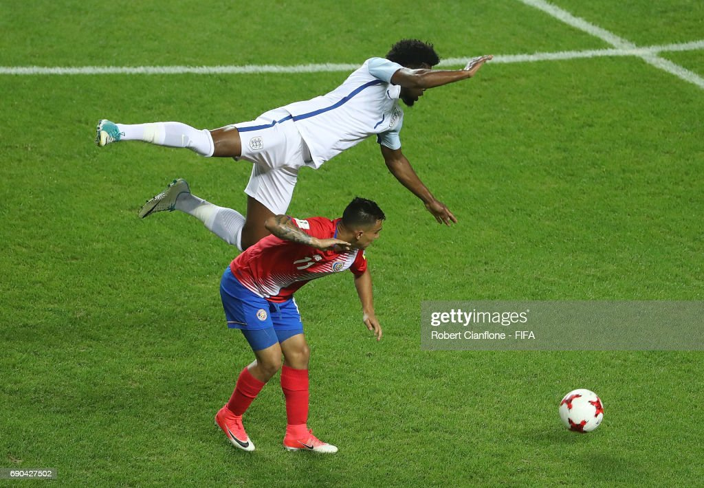 Josh Onomah of England leaps over Randall Leal of Costa Rica during the FIFA U-20 World Cup Korea Republic 2017 Round of 16 match between England and Costa Rica at Jeonju World Cup Stadium on May 31, 2017 in Jeonju, South Korea.