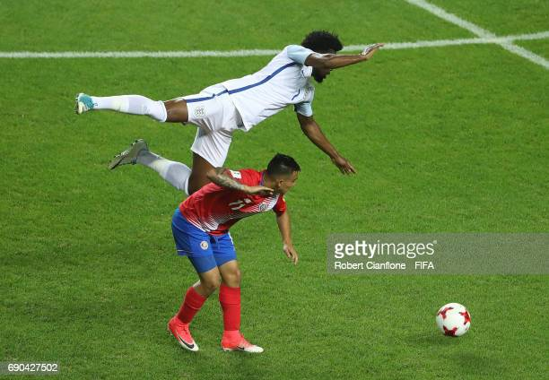 Josh Onomah of England leaps over Randall Leal of Costa Rica during the FIFA U-20 World Cup Korea Republic 2017 Round of 16 match between England and...