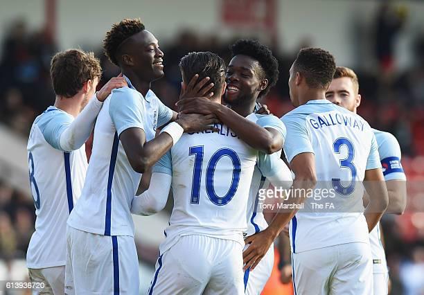 Josh Onomah of England U21 celebrates with Jack Grealish and team mates as he scores their third goal during the UEFA European U21 Championship Group...