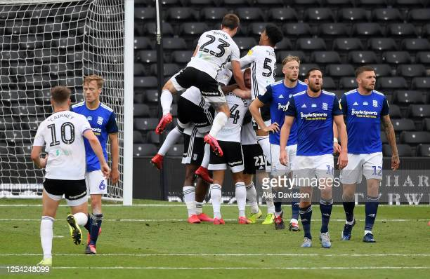 Josh Onomah of Fulham celebrates with teammates after scoring his sides first goal in stoppage time during the Sky Bet Championship match between...