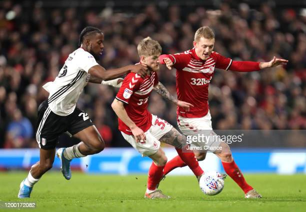Josh Onomah of Fulham chases Hayden Coulson of Middlesbrough during the Sky Bet Championship match between Fulham and Middlesbrough at Craven Cottage...