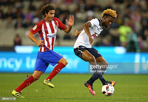 Josh Onomah of Tottenham Hotspur and Tiago of Atletico de Madrid compete for the ball during 2016 International Champions Cup Australia match between...