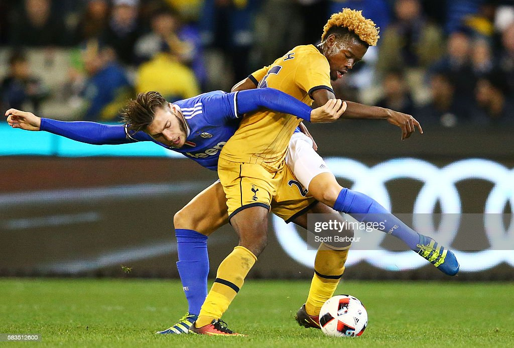Josh Onomah of Tottenham Hotspur and Yoan Severin of Juventus FC compete for the ball during the 2016 International Champions Cup match between Juventus FC and Tottenham Hotspur at Melbourne Cricket Ground on July 26, 2016 in Melbourne, Australia.