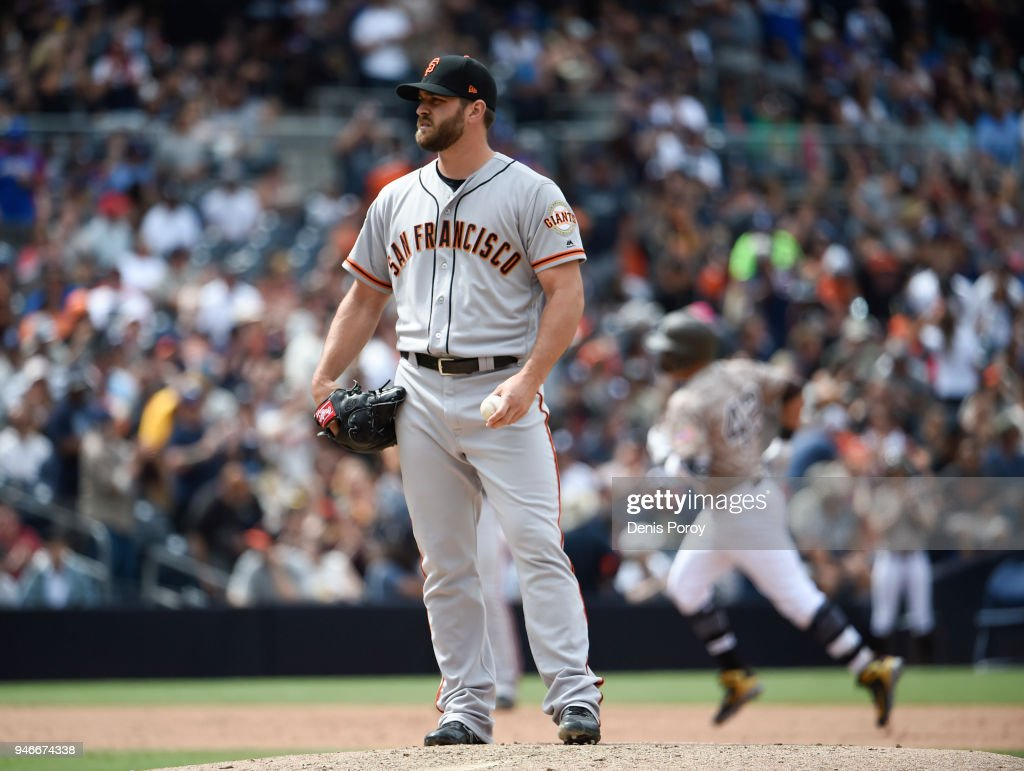 Josh Osich #61 of the San Francisco Giants stands on the mound after giving up a solo home run to Christian Villanueva #22 of the San Diego Padres during the fifth inning of a baseball game at PETCO Park on April 15, 2018 in San Diego, California. All players are wearing #42 in honor of Jackie Robinson Day.