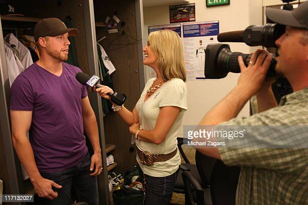 Josh Outman of the Oakland Athletics talks Comcast Sports Net reporter Kate Longworth in the clubhouse after the game against the San Francisco...