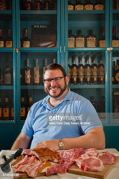 Josh Ozersky founder of Meatopia poses with some of his favorite fare at Low Country restaurant for a preview of his upcoming humane meat festival on...