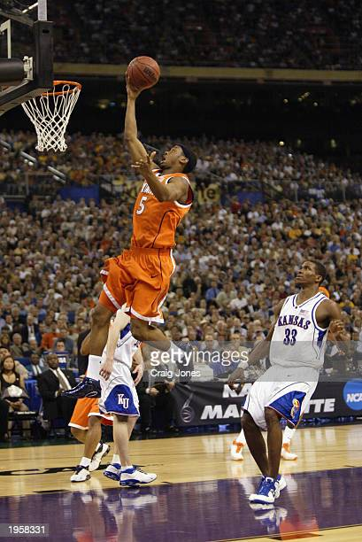 Josh Pace of Syracuse shoots past Bryant Nash of Kansas during the championship game of the NCAA Men's Final Four Tournament on April 7, 2003 at the...