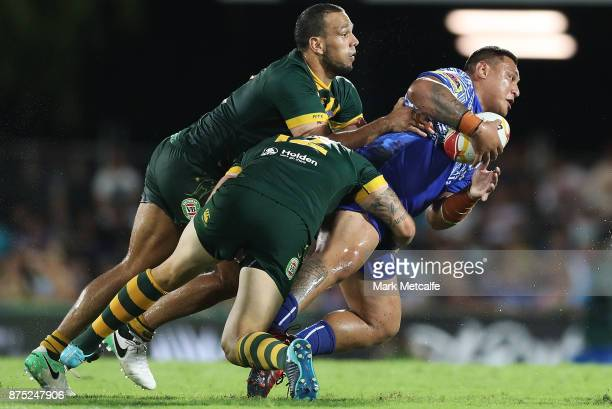 Josh Papali of Samoa is tackled during the 2017 Rugby League World Cup Quarter Final match between Australia and Samoa at Darwin Stadium on November...