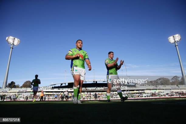Josh Papalii and Luke Bateman of the Raiders look dejected as they leave the field at fulltime during the round 24 NRL match between the Canberra...