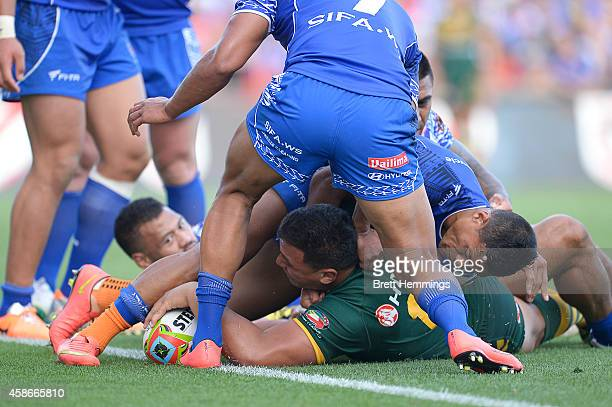 Josh Papalii of Australia scores a try during the Four Nations match between the Australian Kangaroos and Samoa at WIN Stadium on November 9 2014 in...