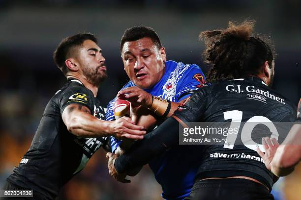 Josh Papalii of Samoa is tackled Shaun Johnson and Adam Blair of the Kiwis during the 2017 Rugby League World Cup match between the New Zealand Kiwis...