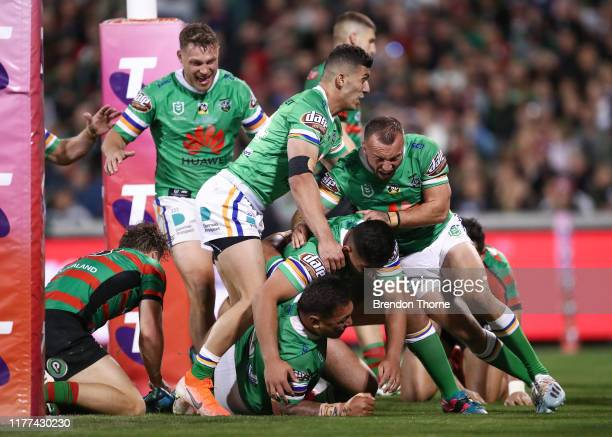 Josh Papalii of the Raiders celebrates with team mates after scoring a try during the NRL Preliminary Final match between the Canberra Raiders and...