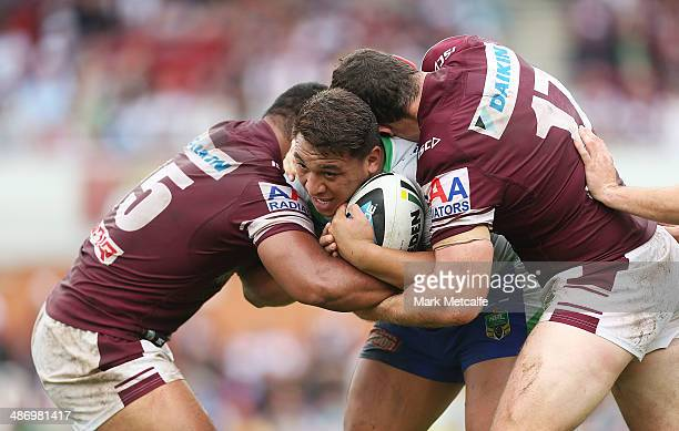 Josh Papalii of the Raiders is tackled by Dunamis Lui and Jason King of the Sea Eagles during the round 8 NRL match between the ManlyWarringah Sea...
