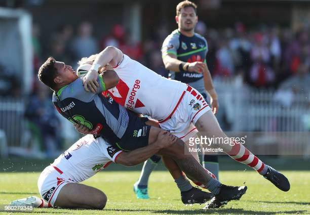 Josh Papalii of the Raiders is tackled by James Graham of the Dragons during the round 11 NRL match between the St George Illawarra Dragons and the...