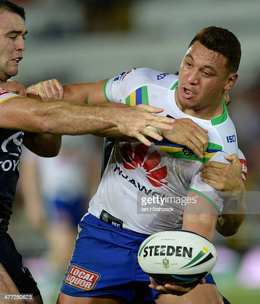 Josh Papalii of the Raiders is tackled by Jason Taumalolo and Kane Linnett of the Cowboys during the round one NRL match between the North Queensland...