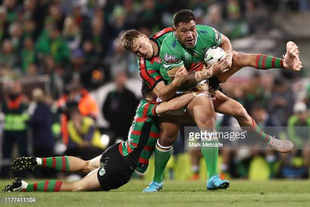 Josh Papalii of the Raiders Is tackled by Liam Knight of the Rabbitohs during the NRL Preliminary Final match between the Canberra Raiders and the...
