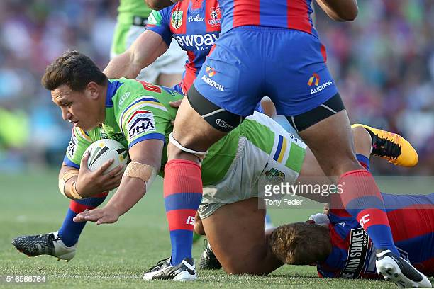 Josh Papalii of the Raiders is tackled by the Knights defence during the round three NRL match between the Newcastle Knights and the Canberra Raiders...