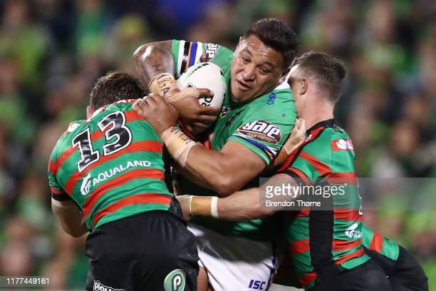 Josh Papalii of the Raiders is tackled by the Rabbitohs defence during the NRL Preliminary Final match between the Canberra Raiders and the South...