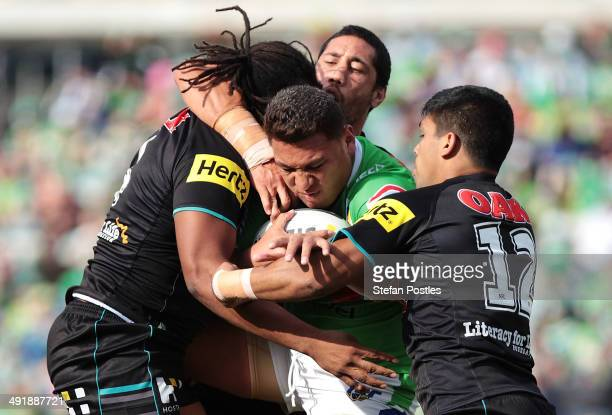 Josh Papalii of the Raiders is tackled during the round 10 NRL match between the Canberra Raiders and the Penrith Panthers at GIO Stadium on May 18...