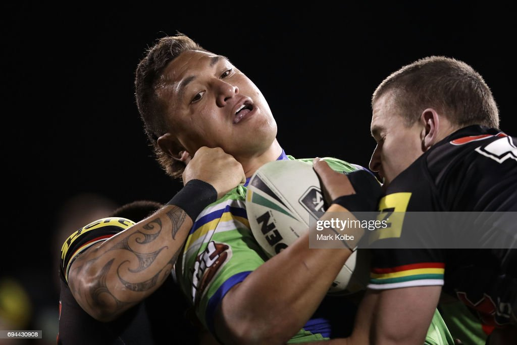 Josh Papalii of the Raiders is tackled during the round 14 NRL match between the Penrith Panthers and the Canberra Raiders at Carrington Park on June 10, 2017 in Bathurst, Australia.