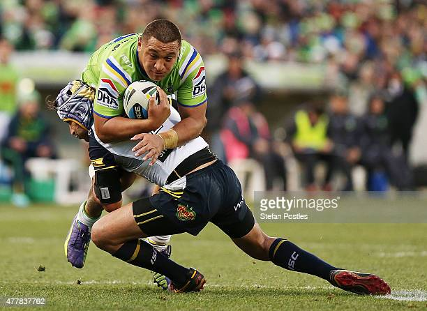 Josh Papalii of the Raiders is tackled during the round 15 NRL match between the Canberra Raiders and the North Queensland Cowboys at GIO Stadium on...