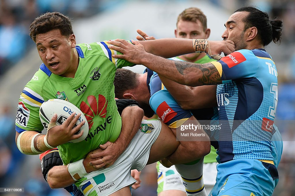 Josh Papalii of the Raiders is tackled during the round 16 NRL match between the Gold Coast Titans and the Canberra Raiders at Cbus Super Stadium on June 26, 2016 in Gold Coast, Australia.
