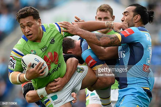 Josh Papalii of the Raiders is tackled during the round 16 NRL match between the Gold Coast Titans and the Canberra Raiders at Cbus Super Stadium on...