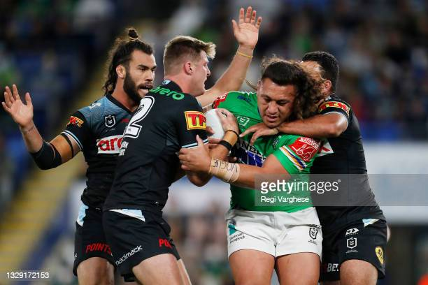 Josh Papalii of the Raiders is tackled during the round 18 NRL match between the Canberra Raiders and the Cronulla Sharks at Cbus Super Stadium, on...