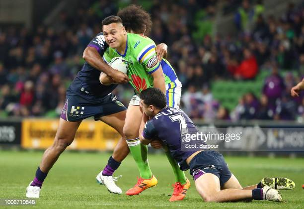 Josh Papalii of the Raiders is tackled during the round 20 NRL match between the Melbourne Storm and the Canberra Raiders at AAMI Park on July 28...