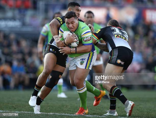 Josh Papalii of the Raiders is tackled during the round 21 NRL match between the Penrith Panthers and the Canberra Raiders at Panthers Stadium on...