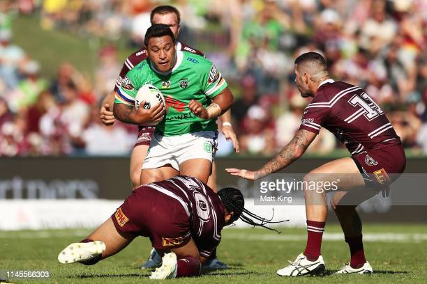Josh Papalii of the Raiders is tackled during the round 7 NRL match between the Manly Warringah Sea Eagles and the Canberra Raiders at Lottoland on...