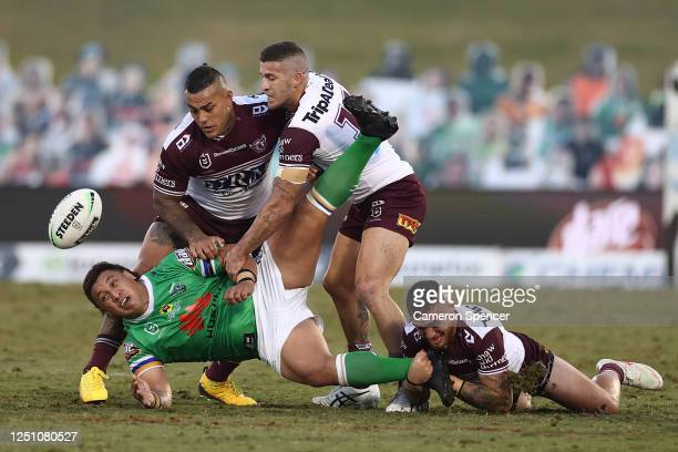 Josh Papalii of the Raiders is tackled during the round six NRL match between the Canberra Raiders and the Manly Sea Eagles at Campbelltown Stadium...