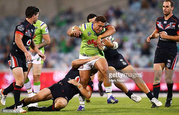 Josh Papalii of the Raiders is tackled during the round two NRL match between the Canberra Raiders and the New Zealand Warriors at GIO Stadium on...
