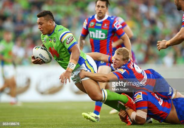 Josh Papalii of the Raiders is tackled during the round two NRL match between the Canberra Raiders and the Newcastle Knights at GIO Stadium on March...