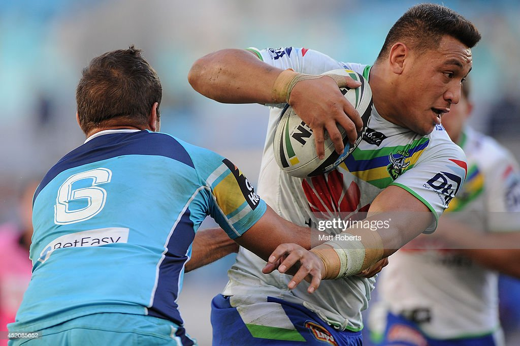 Josh Papalii of the Raiders takes on the defence during the round 18 NRL match between the Gold Coast Titans and the Canberra Raiders at Cbus Super Stadium on July 13, 2014 on the Gold Coast, Australia.