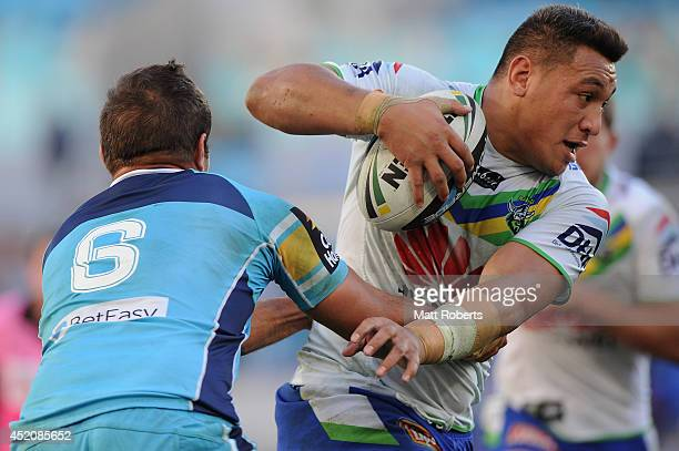 Josh Papalii of the Raiders takes on the defence during the round 18 NRL match between the Gold Coast Titans and the Canberra Raiders at Cbus Super...