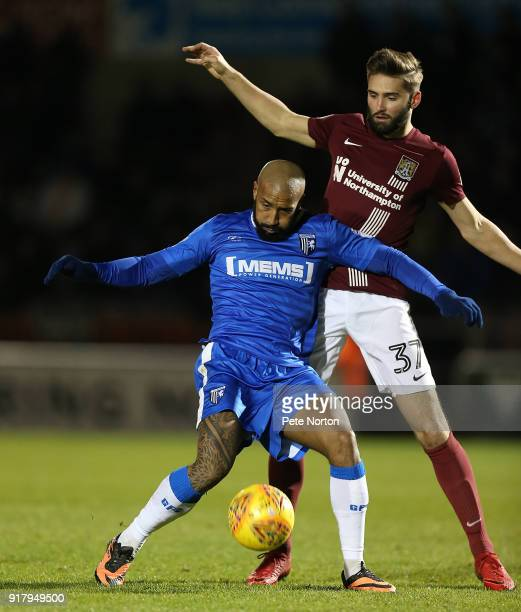 Josh Parker of Gillingham attempts to control the ball under pressure from Jordan Turnbull of Northampton Town in action during the Sky Bet League...